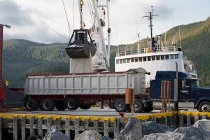 Salt ship unloading its cargo